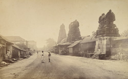Street view in Tanjore showing three small pagodas [gopuras].